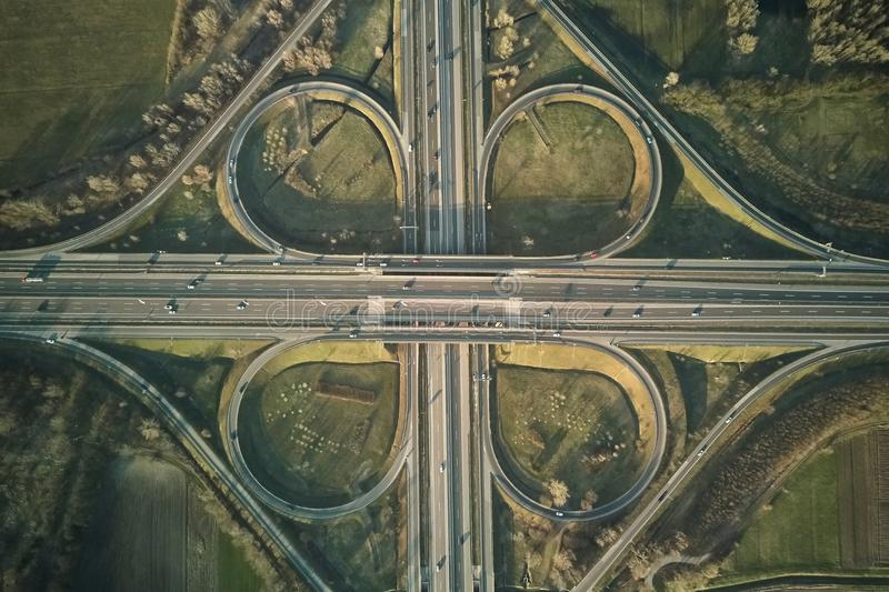 Freeway cloverleaf interchange. Highway intersection aerial drone photo stock image