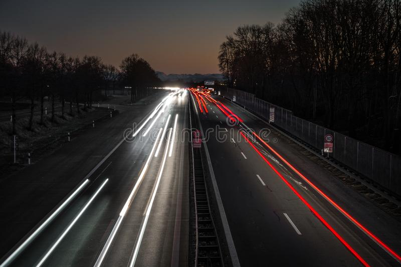 Highway leading in to the alps by sunset stock photography
