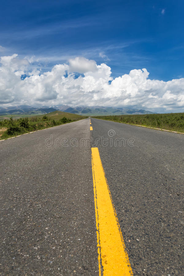 The highway leading to the clouds. Straight road seems to connect the distant clouds in the sky, I used the camera to record the beautiful scenery royalty free stock photography