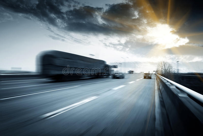 Highway. Motion trucks on the freeway royalty free stock photos
