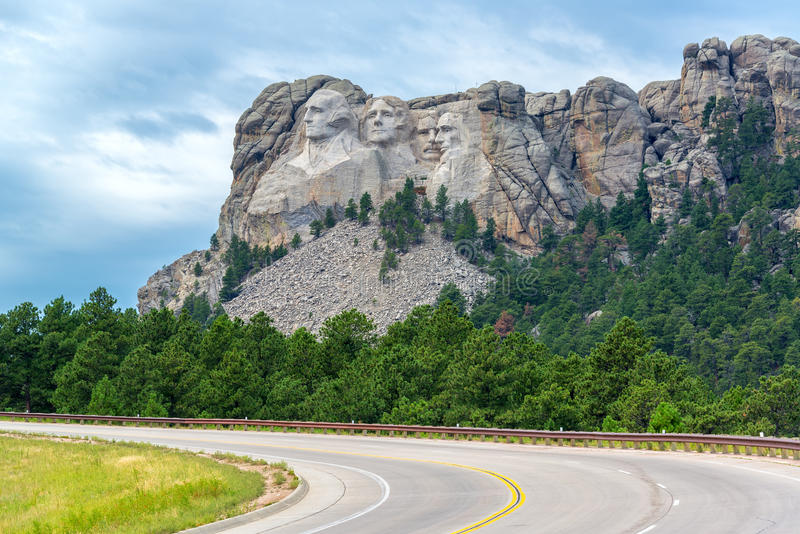Highway and Mount Rushmore. View of a highway leading to Mount Rushmore National Monument in South Dakota royalty free stock photos