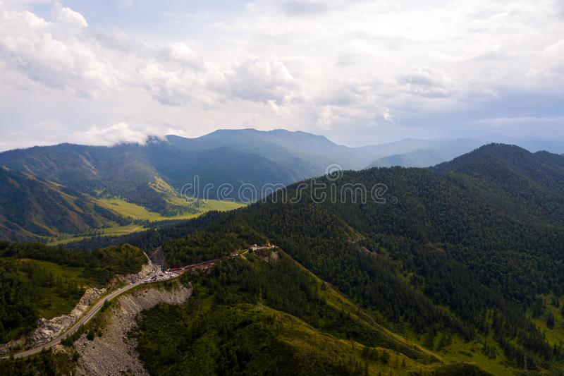 . Highway at mountains. Landscape mountain with beautiful forest  with turquoise. Panoramic. Travel background. Highway at mountain. Quadrocopter Highlands stock image