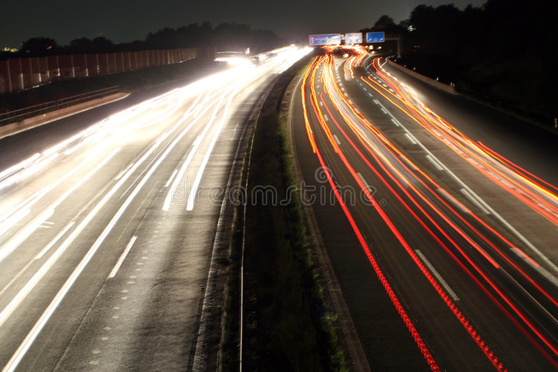 Highway at night. Bulb shot - Traffic on a highway at night stock image