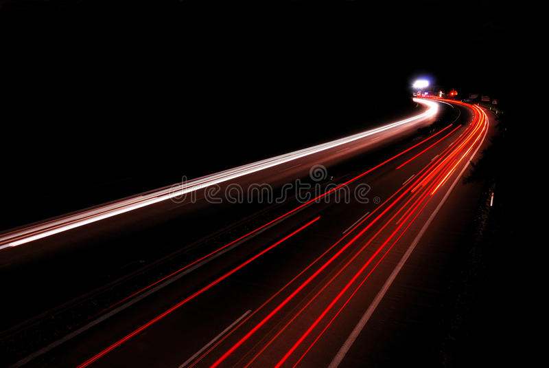 Highway night. Night traffic on the highway royalty free stock photo