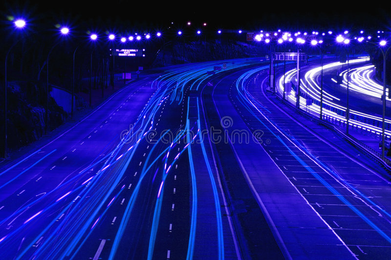 Highway At Night In Blue royalty free stock photography