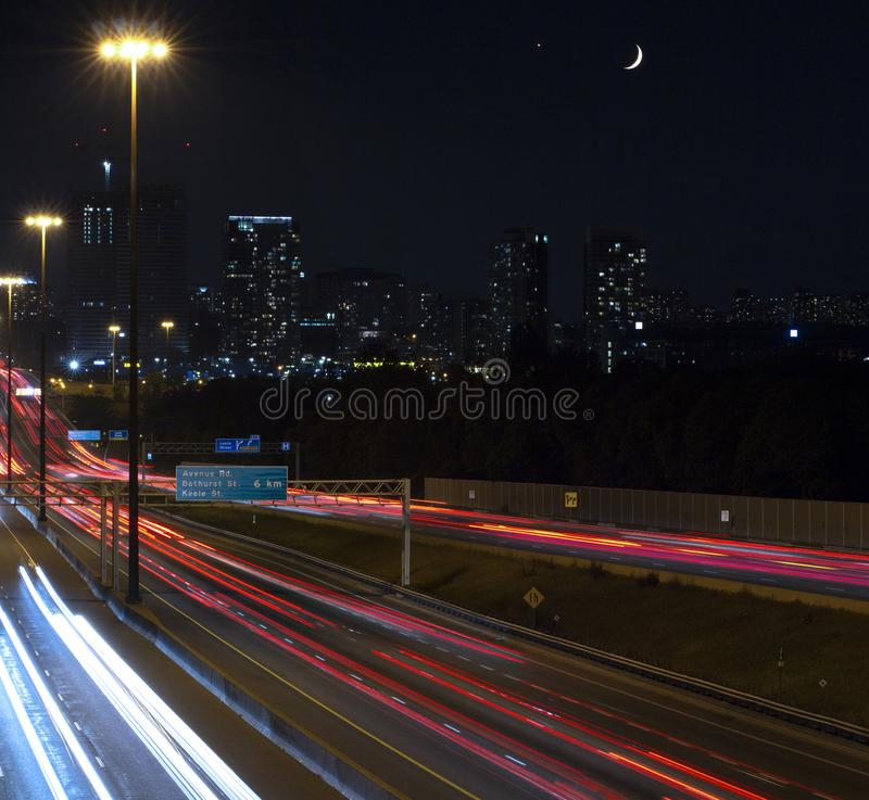 Highway 401 at night with crescent moon royalty free stock image