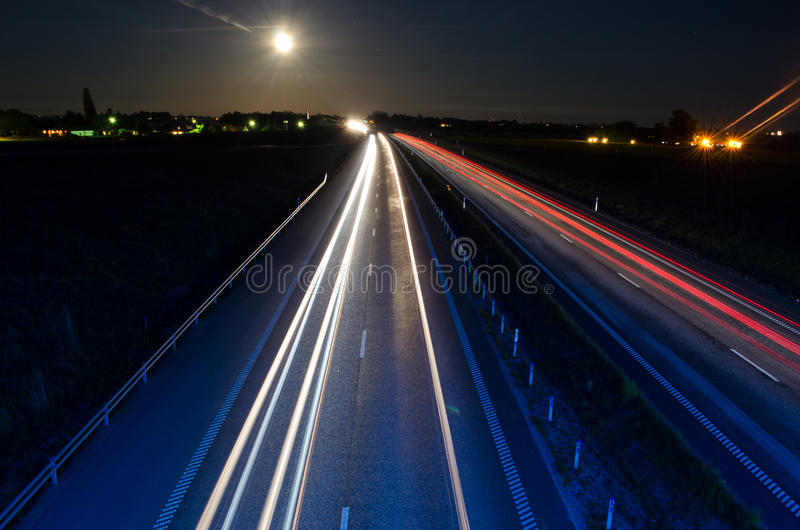 Highway at night stock photo