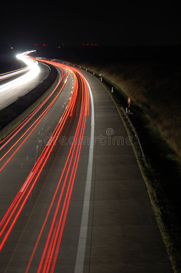 Highway at night with traffic stock photography