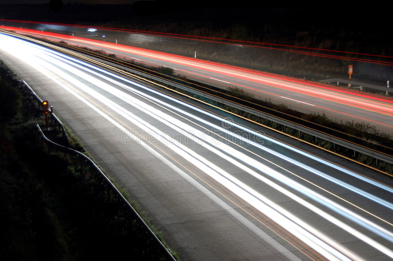 Highway at night with traffic stock photo