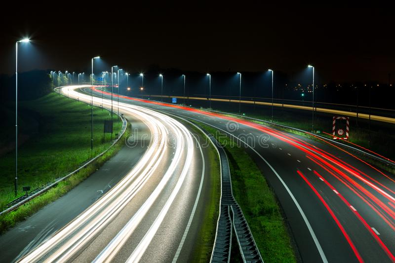 Highway night traffic with light trails stock images