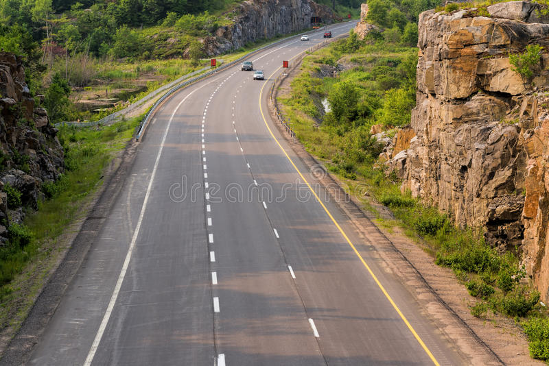 Highway 400 in northern Ontario. Through a rock cut royalty free stock photos