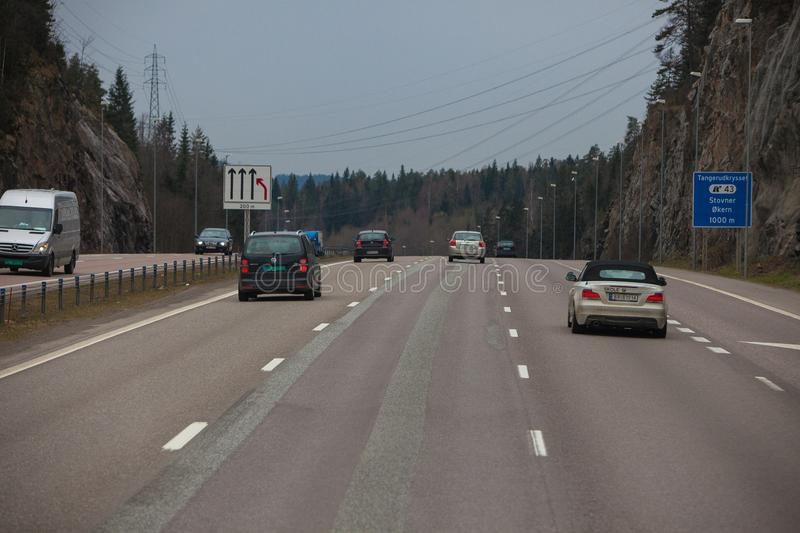 Highway airport city oslo cars lanes cliff mountains royalty free stock photography