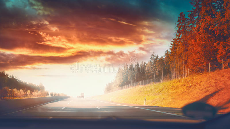 Highway road in autumnal landscape with Beautiful sky and sunlight royalty free stock photography