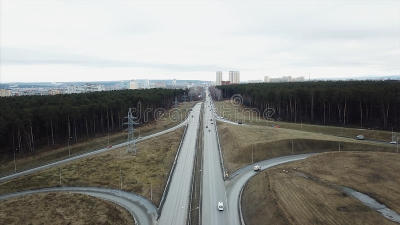 Highway road in forest landscape. Video. Aerial view of cars on highway at nature. Aerial landscape of highway road royalty free stock photo