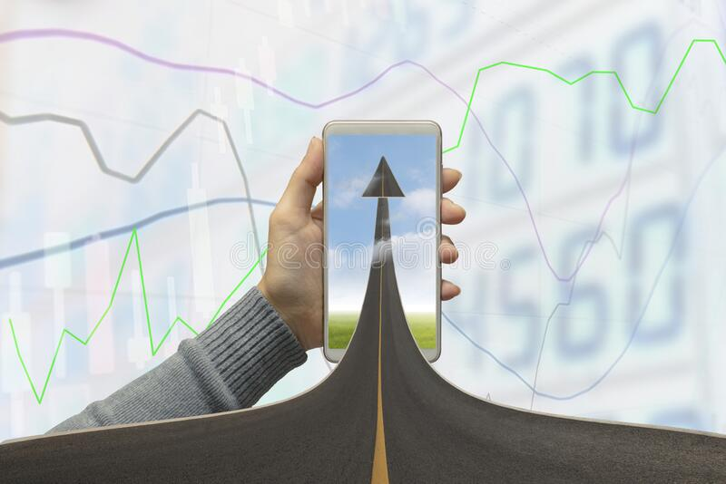Highway road going up as an arrow in mobile phone with stock graph background. Concept business, symbolizing the direction to royalty free stock images