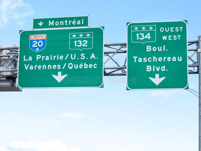 Highway road sign indicating the direction of Montreal and the way on the Interstate motorway to the USA Canada border royalty free stock photography