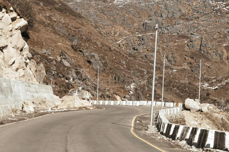 Highway road view of India China border near Nathu La mountain pass in Himalayas which connects Indian state Sikkim with China`s royalty free stock images