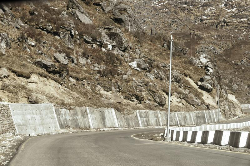 Highway road view of India China border near Nathu La mountain pass in Himalayas which connects Indian state Sikkim with China`s. Tibet Region, trisection point stock image