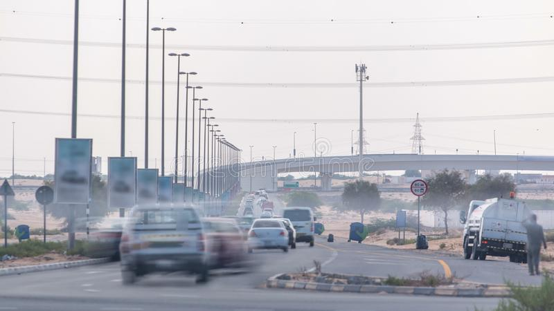Highway roads with traffic timelapse in a big city from Ajman to Dubai before sunset. Transportation concept. stock photo