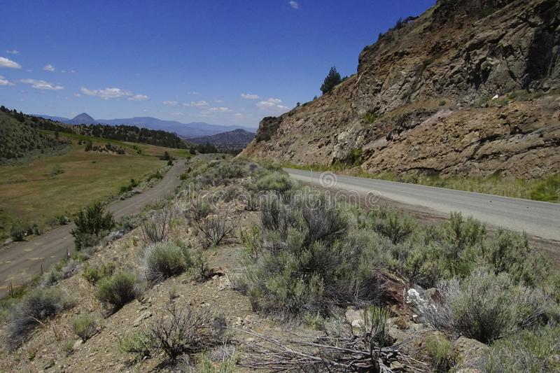 Highway through rolling hills of John Day Fossil Beds National Monument royalty free stock photography