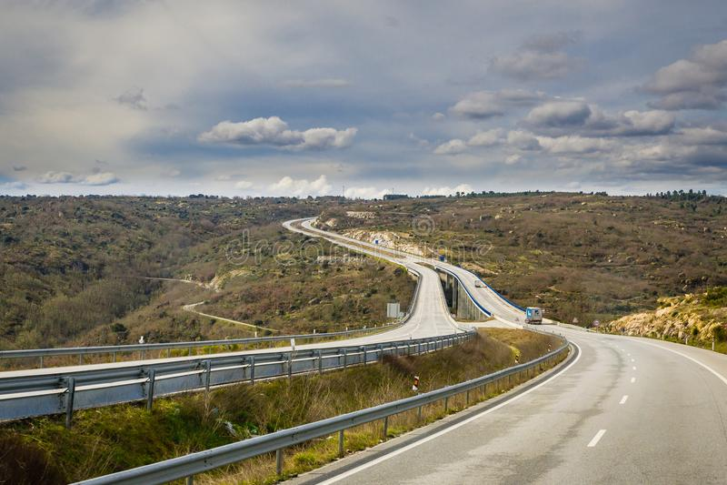 The highway in rural hills of Spain royalty free stock image