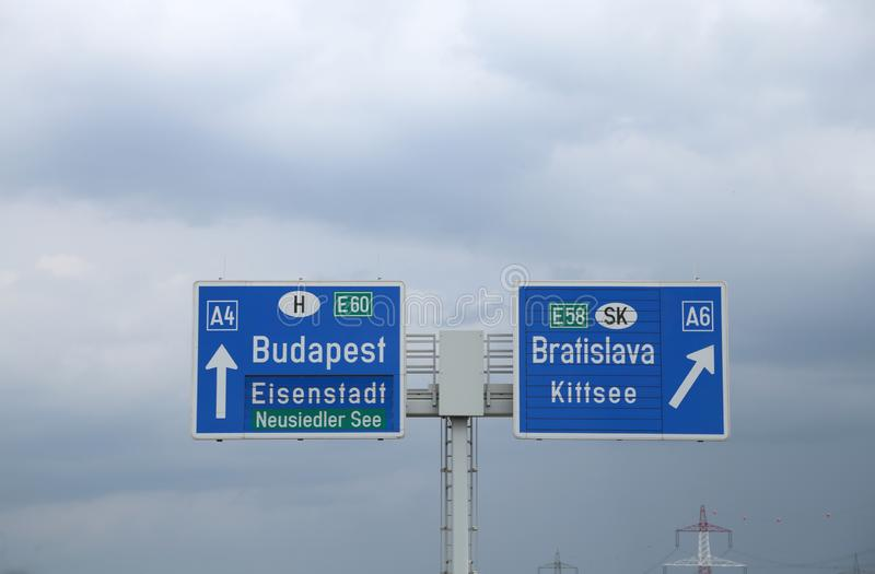 Highway sign on the border between Hungary and Slovakia with dir. Large highway sign on the border between Hungary and Slovakia with directions to go to Budapest royalty free stock images