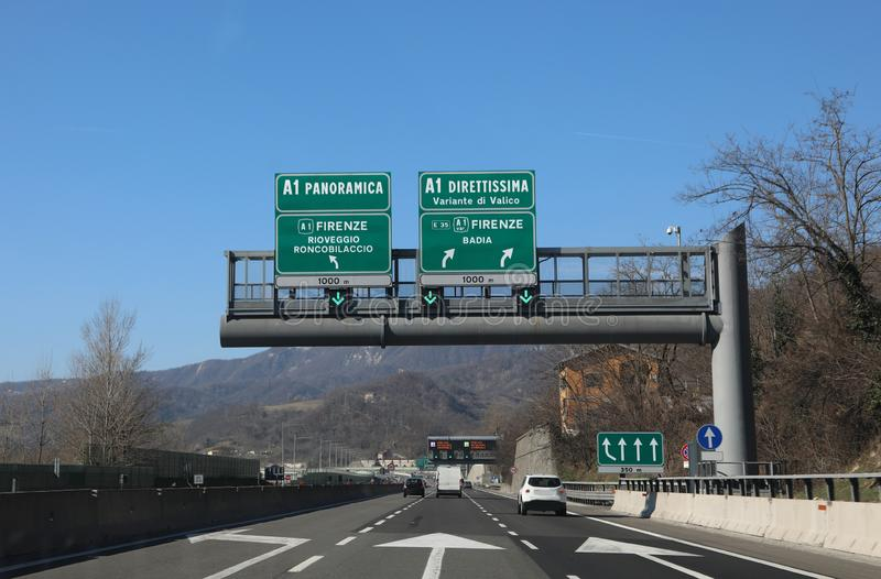 Highway sign with the signs of the junction to go to Florence on. The panoramic road or on the Direttissima road which means very fast in italian language royalty free stock image