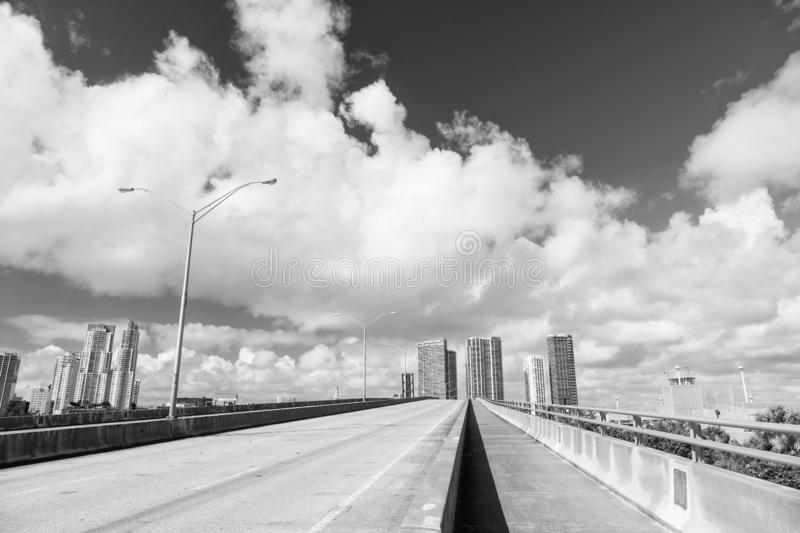 Highway with skyscrapers on sky royalty free stock image
