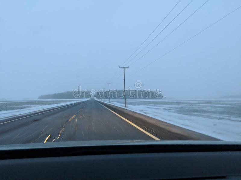 Highway during snow storm. stock image