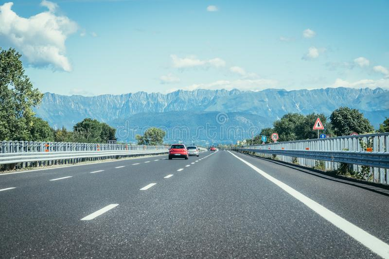 Highway on a sunny summer day, travelling. Highway travel holiday cars charge transport mobility road empty summer tour season blue sky infrastructure traffic stock photos