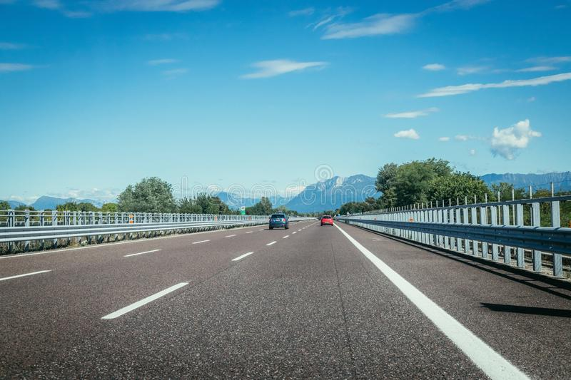 Highway on a sunny summer day, travelling. Highway travel holiday cars charge transport mobility road empty summer tour season blue sky infrastructure traffic royalty free stock image