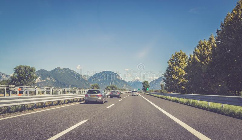 Highway on a sunny summer day, travelling. Highway travel holiday cars charge transport mobility road empty summer tour season blue sky infrastructure traffic stock photo