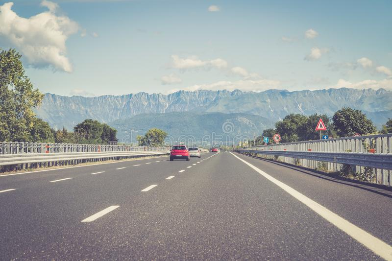 Highway on a sunny summer day, travelling. Highway travel holiday cars charge transport mobility road empty summer tour season blue sky infrastructure traffic royalty free stock photography