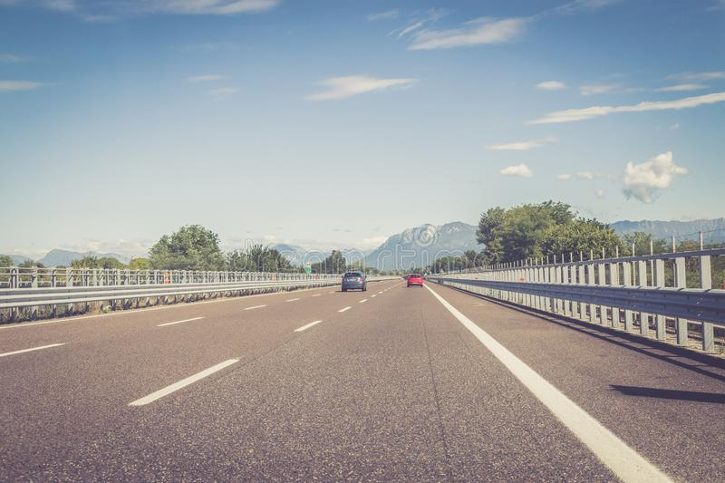 Highway on a sunny summer day, travelling. Highway travel holiday cars charge transport mobility road empty summer tour season blue sky infrastructure traffic royalty free stock photos