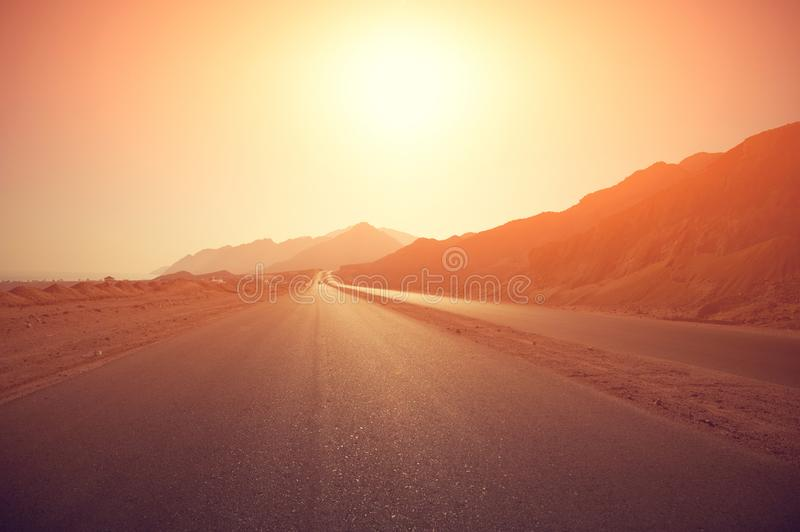 Highway at sunrise. Highway with the rising sun on the horizon royalty free stock photography