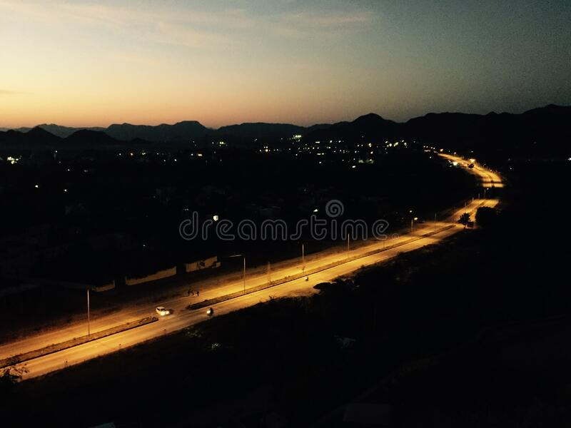 Highway at sunset royalty free stock photos