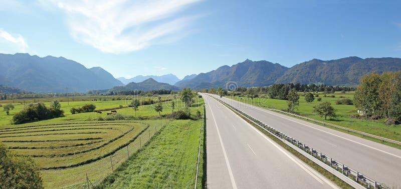 Highway to garmisch-partenkirchen, germany. Highway to garmisch-partenkirchen and the bavarian alps, germany stock image