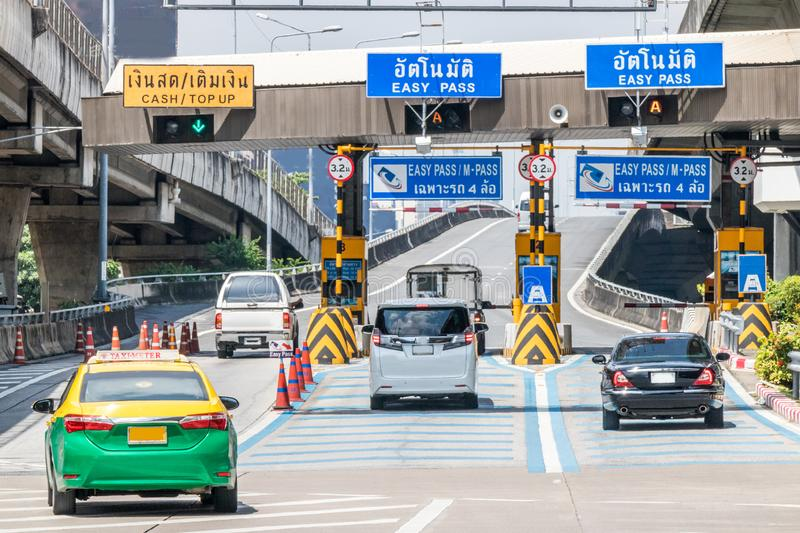Highway toll booths. Cars passing through highway toll booths, Bangkok, Thailand stock images
