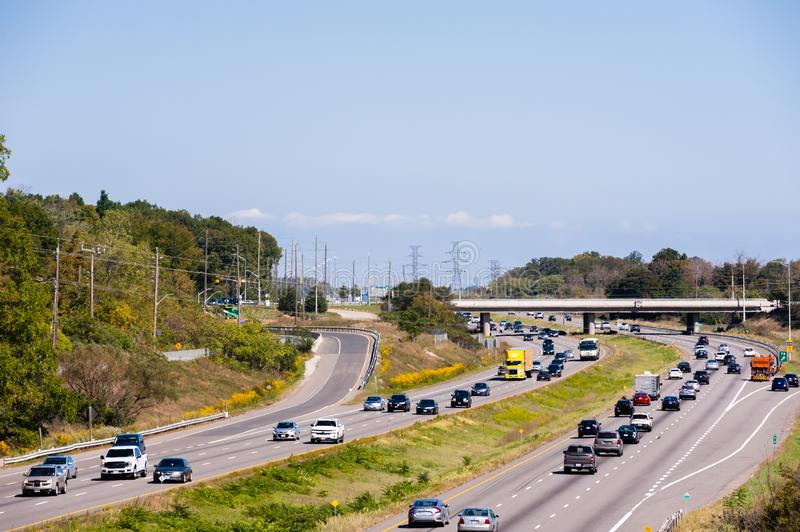 Highway traffic near ramps and overpass in Burlington, Ontario, Canada. BURLINGTON, CANADA - SEPTEMBER 23, 2018: Traffic on Highway 403 near the interchange with royalty free stock photo