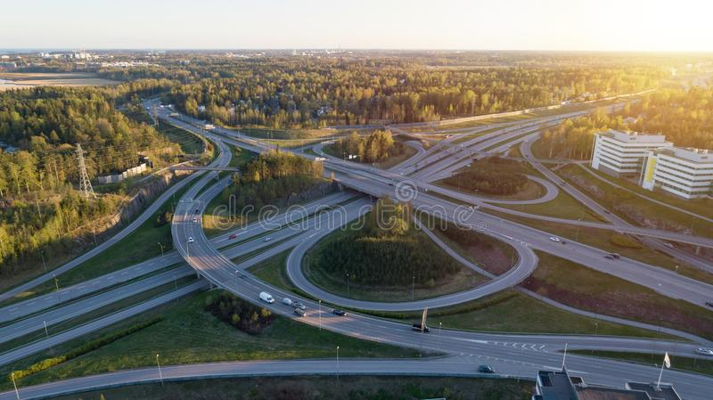 Highway transportation system highway interchange at sunset. Summer time green road way. royalty free stock photography