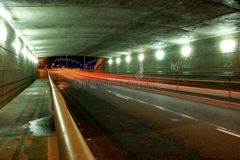 Highway tunnel in night stock image