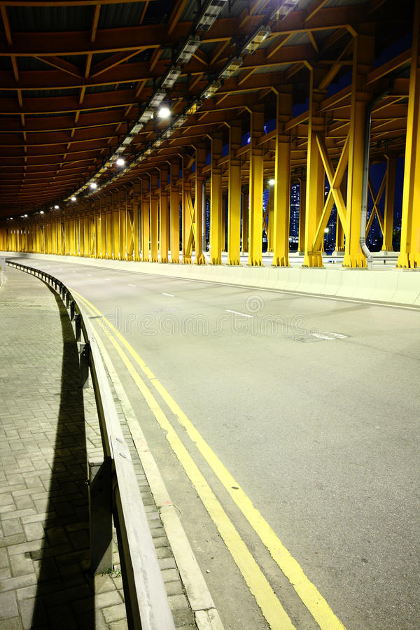 Highway tunnel at night stock image