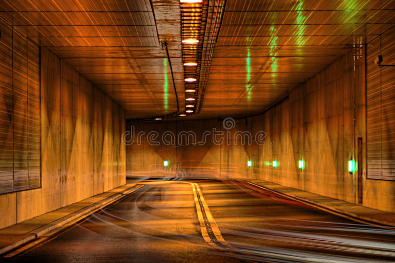 Highway tunnel at night royalty free stock image