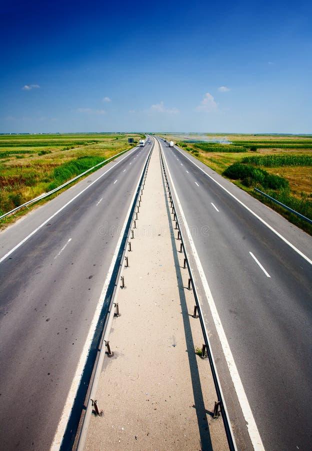 Highway under blue sky stock photos