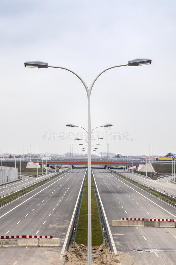 Highway under construction. Road partly ready. Barricade on a highway stopping all vehicles stock images
