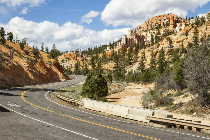A highway winds through Bryce Canyon National Park stock images
