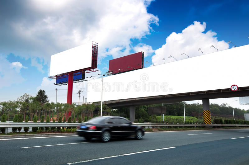 Highways and billboards. Highway, next to the countless billboards erected royalty free stock photo