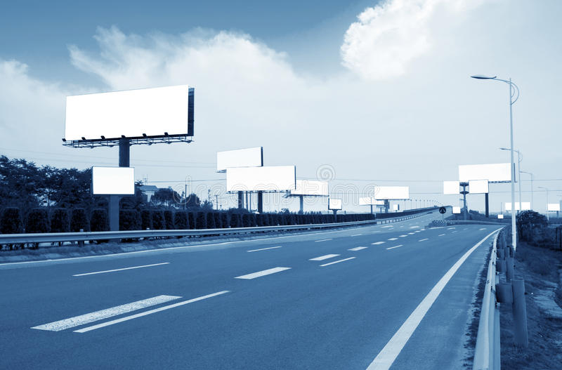 Highways and billboards. Highway, next to the countless billboards erected stock image