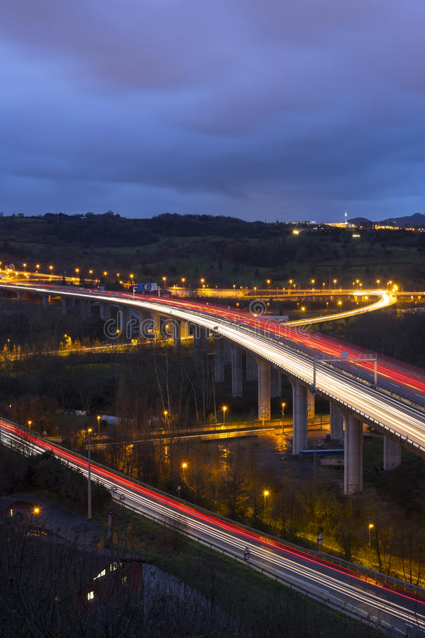 Highways with cars and lights. In the mountain stock image