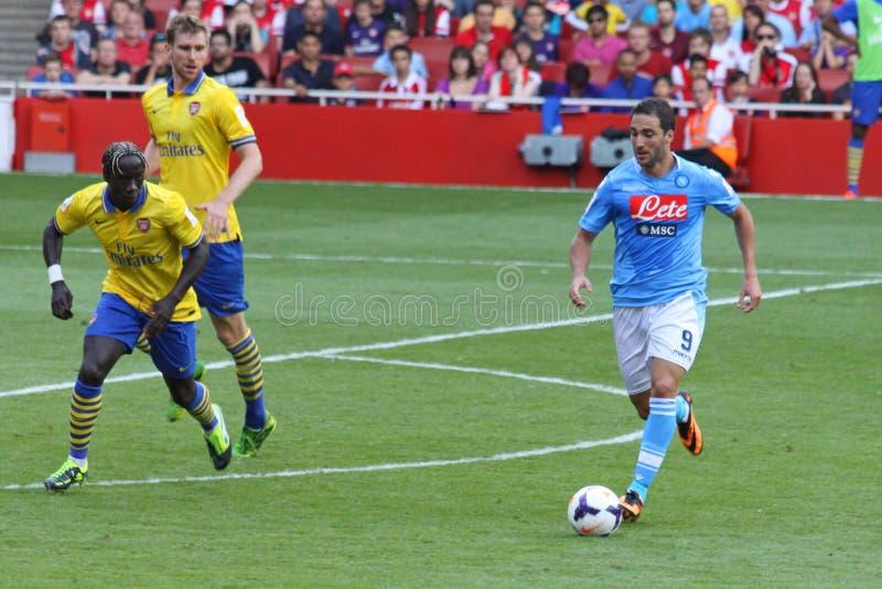 Higuain in arsenaal-Napoli stock foto's